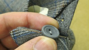 Sewing on a cuff button
